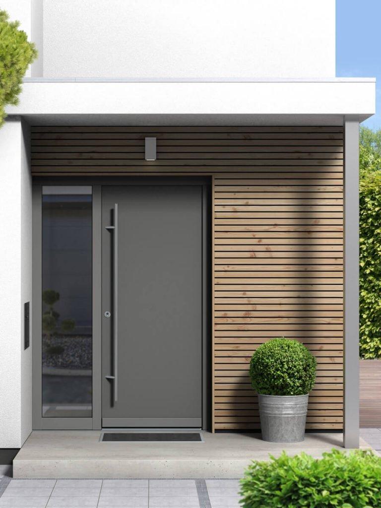 Stilvoller Eingang eines popularc Einfamilienhauses aus Holz